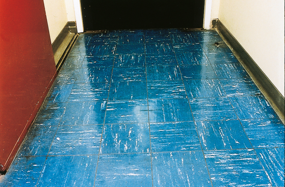 Vinyl floor tiles containing asbestos