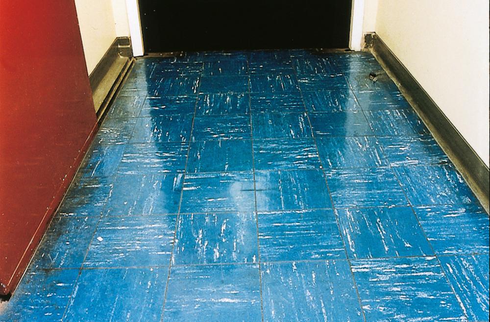 Vinyl floor tiles containing asbestos