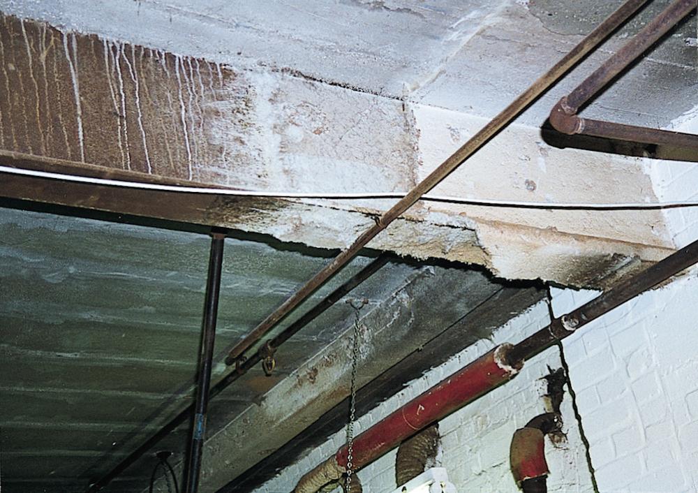 Sprayed asbestos coatings