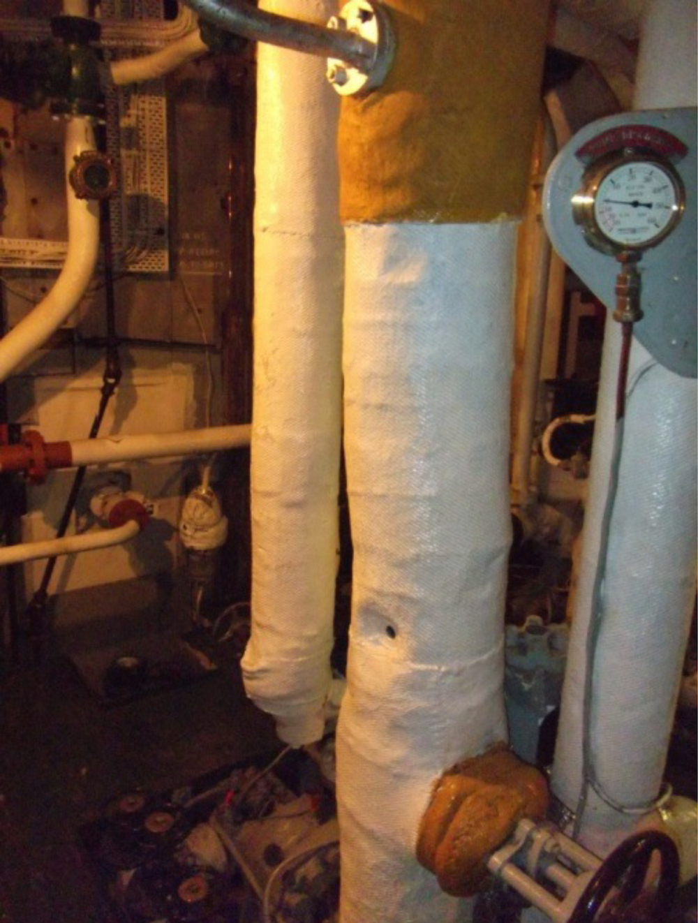 Asbestos insulation around pipework and boilers